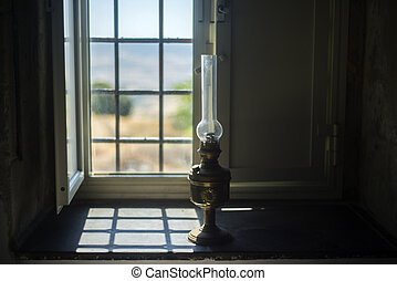 windowsill and traditional oil lamp - Traditional eighteen...