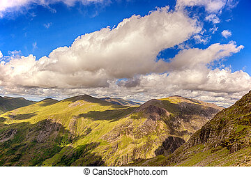 Snowdonia - Blue sky and clouds across the mountains of...