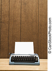 Typewriter. - Vintage blue typewriter on desk with wood...
