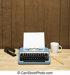 Typewriter on desk - Vintage typewriter, coffee cup, pencil...