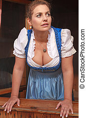 What will the weather - Young peasant woman in a dirndl Look...