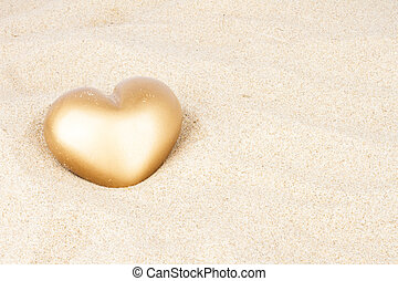 Golden heart in the sand
