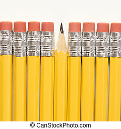 Row of pencils. - Even row of eraser ends of pencils except...