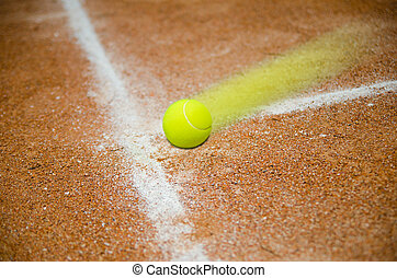 Fast tennis ball - Fats tennis ball hitting court on the...
