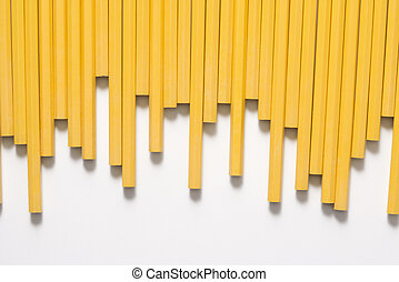 Row of pencils - Uneven row of unsharpened pencils