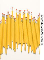 Uneven row of pencils.