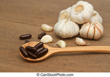 Garlic  herbal supplement pills , alternative medicine