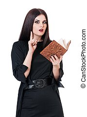 Inquisitive witch with book for spells isolated on a white...