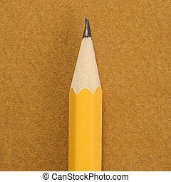 Sharp pencil - Close up of sharp pencil tip on tan...