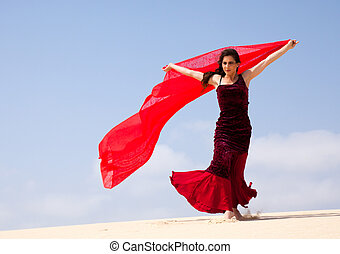 flamenco in the dunes - Flamenco dancer in the long dress in...