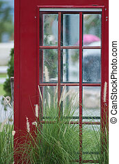 telephone box - Red telephone box with green grass...