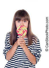 Cute fun little girl holding big lolly pop on white...