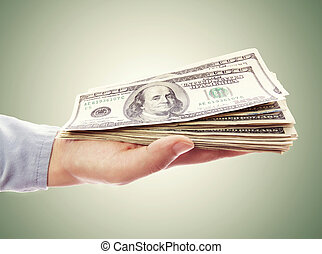 Hand Holding Pile of Cash - Wad of one hundred dollar bills...