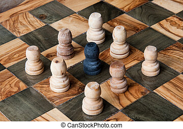 unfair - black pawn ringed by some white pawns