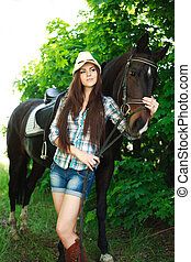 cowgirl with horse in green