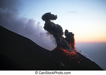 Erupting volcano at dawn - Stromboli main crater erupting at...