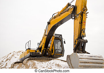 excavator quarry sand pit snow winter industry - closeup of...