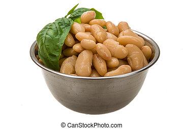 Tinned bean with basil leaf