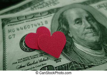 red hearts - closeup of two red hearts on cash...