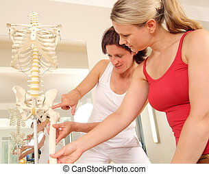 Specialist explaining the hip to a patient
