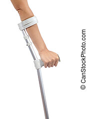 Woman hand using a crutch isolated on a white background...