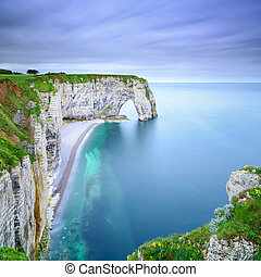 Etretat, la Manneporte natural rock arch wonder, cliff and...