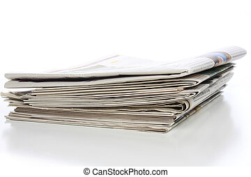 Stack of newspapers - Stack of local, regional, national and...