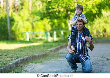 Portrait of father and son in the park.