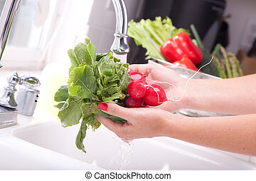 Washing Radishes - Woman Washing Radish in the Kitchen Sink.