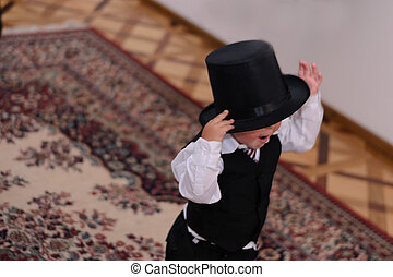 Blind child waring suit and top hat. - Nice child 2 years...