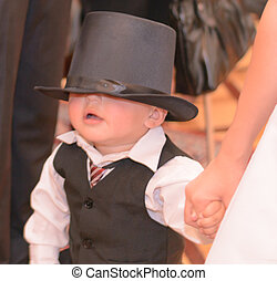 Blind child waring suit and top hat - Nice child 2 years old...