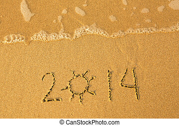 2014 - written in sand on beach texture - soft wave of the sea.
