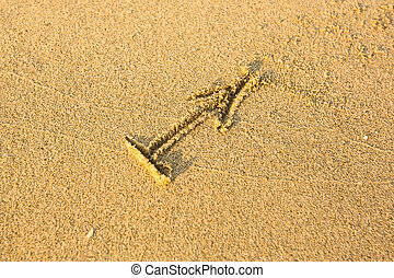 Zodiac sign Sagittarius, drawn on the facture beach sand