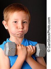 Health and Fitness Boy - Young boy lifting weight that is...