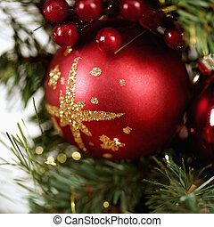 Christmas decorations. - Close up of red ornament and...