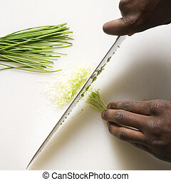 Knife chopping chives.