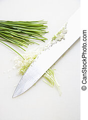 Chives with knife. - Freshly chopped chives with kitchen...