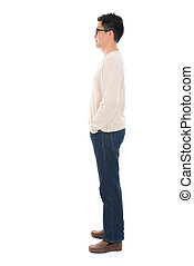 Side view full body casual Asian man standing isolated on...