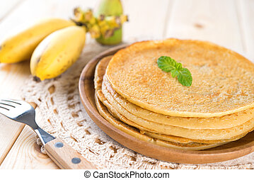 Banana pancake on dining table - Banana pancakes or crepe on...