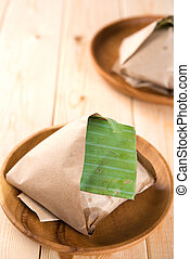 Nasi Lemak packed in banana leaf - Traditional Malay food...