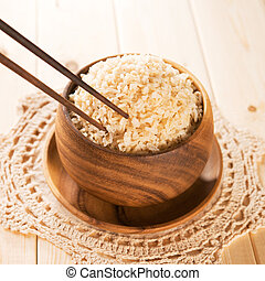 Eating rice with chopsticks - Close up cooked organic...