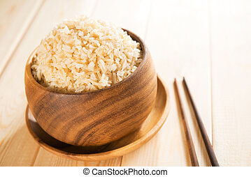 Cooked organic basmati brown rice with chopsticks