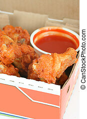chicken wings and dip - cardboard delivery box with crispy...