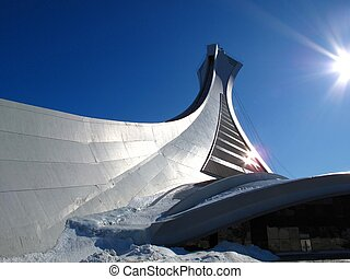 The Olympic stadium in Montreal with direst sunlight