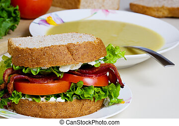 Soup and sandwich - A BLT sandwich and a bowl of split pea...