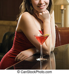 Woman at bar. - Taiwanese mid adult woman in red dress...