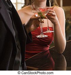 Couple with martinis - Taiwanese mid adult woman and...