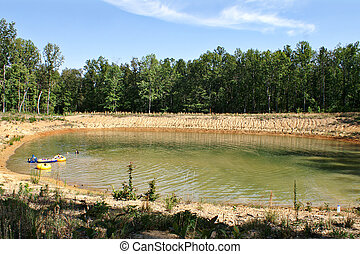 Manmade Swimming Hole - Floats and Kids at a manmade...