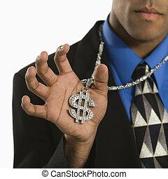 Man wearing money sign - African American man wearing...