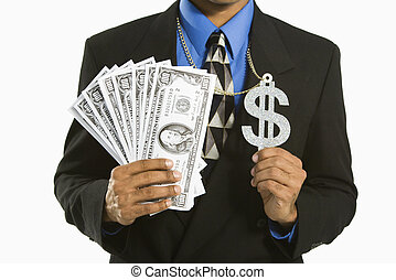 Man with money. - African American man in suit wearing...
